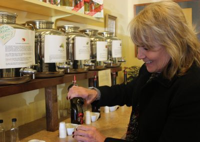 co-own-carol-campbell-pours-our-hand-picked-oil-and-vinegar-tasting-selection
